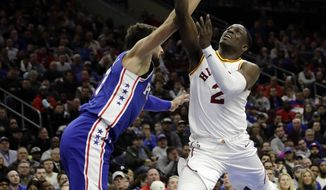 Indiana Pacers' Darren Collison, right, goes up for a shot against Philadelphia 76ers' Marco Belinelli during the first half of an NBA basketball game, Tuesday, March 13, 2018, in Philadelphia. (AP Photo/Matt Slocum)