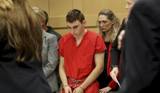 This Feb. 19, 2018, file photo shows Nikolas Cruz appearing in court for a status hearing before Broward Circuit Judge Elizabeth Scherer in Fort Lauderdale, Fla. Florida prosecutors announced Tuesday, March 13 that they will seek the death penalty against Cruz, a former student charged in the fatal shooting of 17 people at Marjory Stoneman Douglas High School last month. (Mike Stocker/South Florida Sun-Sentinel via AP, Pool, File)
