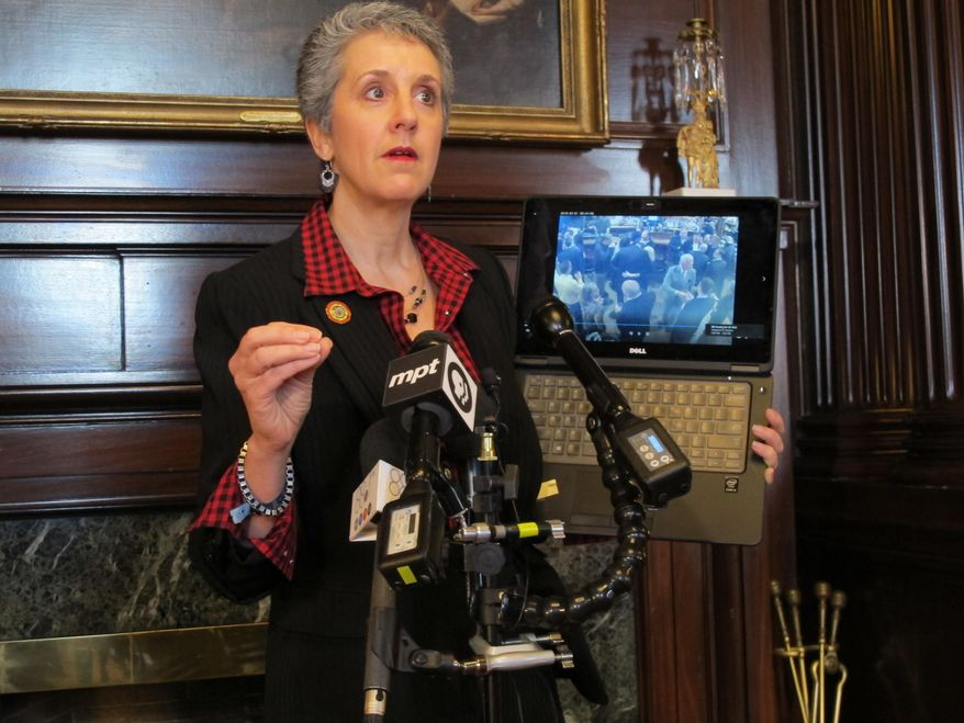 Maryland state Sen. Cheryl Kagan shows security video during a news conference on Tuesday, March 13, 2018 at the Maryland State House in Annapolis, Maryland. She says the video supports her allegations that a lobbyist touched her inappropriately after putting his hand on her back at a tavern earlier this month. The lobbyist is adamantly denying the allegations, saying the video shows he did not touch her inappropriately.  (AP Photo/Brian Witte)