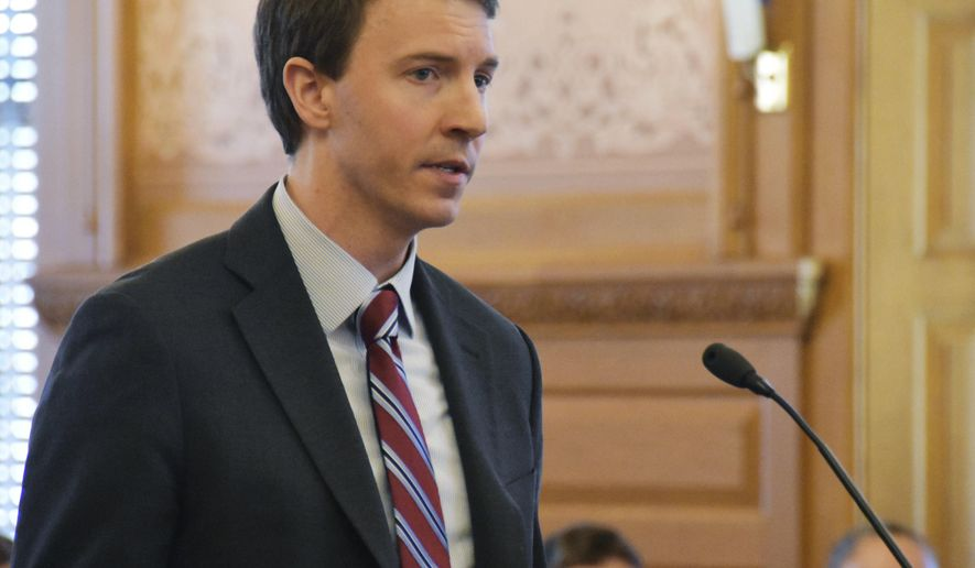 Bryan Seeley, a Major League Baseball senior vice president, testifies on a bill that would legalize sports betting in Kansas during a legislative committee hearing, Tuesday, March 13, 2018, at the Statehouse in Topeka, Kan. The league says it is neutral on bill, opposing sports betting but wanting a piece of the revenues if Kansas legalizes it. (AP Photo/Mitchell Willetts)