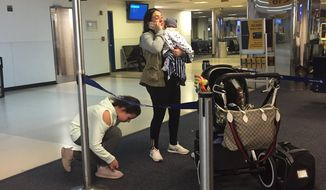 """Passenger Maggie Gremminger posted a photo on Twitter of the dog's owner and children after the flight. """"I want to help this woman and her daughter. They lost their dog because of an @united flight attendant. My heart is broken,"""" she wrote. (twitter("""