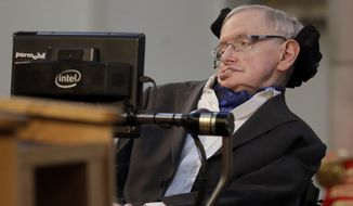 """Britain's Professor Stephen Hawking receives the Honorary Freedom of the City of London during a ceremony at the Guildhall in the City of London. Cambridge University has put Stephen Hawking's doctoral thesis online on Monday, Oct. 23, 2017, triggering such interest that it crashed the university's website. Completed in 1966 when Hawking was 24, """"Properties of Expanding Universes"""" explores ideas about the origins of the universe that have resonated through the scientists career. (AP Photo/Matt Dunham, file)"""
