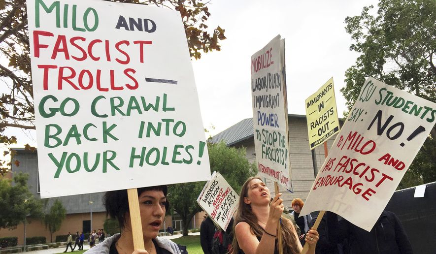 Demonstrators protest outside a speech by conservative provocateur Milo Yiannopoulos, sponsored by a Republican student group at California State University, Fullerton, Tuesday, Oct. 31, 2017. At least one fight broke out and several people were arrested. They were mostly peaceful, but one woman protesting the event attacked a Yiannopoulos supporter with punches before a third person subdued her with pepper spray. (AP Photo/Amanda Lee Myers)