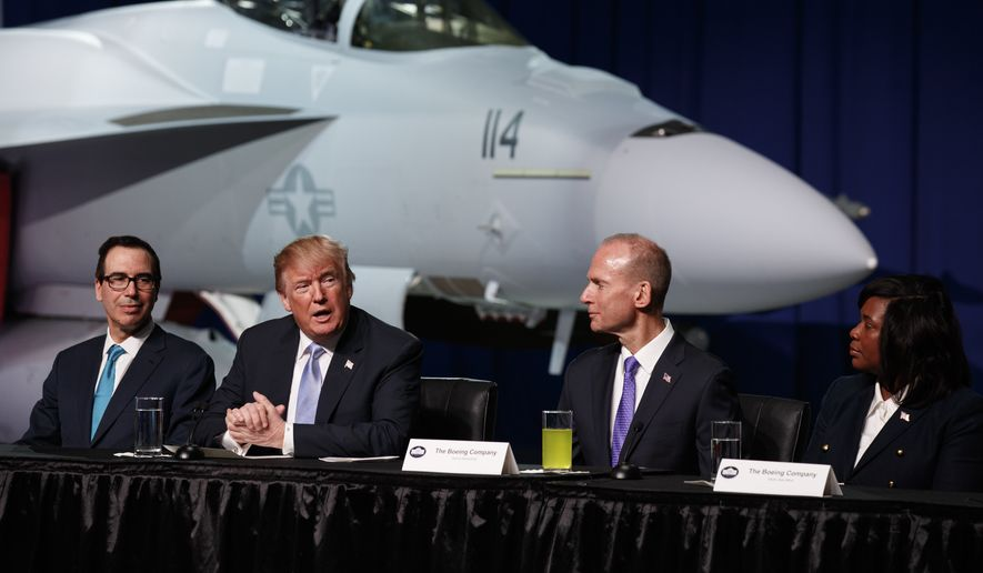 President Donald Trump speaks during a roundtable discussion on tax policy at the Boeing Company, Wednesday, March 14, 2018, in St. Louis. From left, Treasury Secretary Steve Mnuchin, Trump, Boeing CEO Dennis Muilenburg, and Boeing employee Hazel Jean Mims. (AP Photo/Evan Vucci)