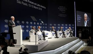 "In this photo released by Brazil's presidential press office, Brazil's President Michel Temer, left, speaks during the opening plenary session of the World Economic Forum for Latin America, in Sao Paulo, Brazil, Wednesday, March 14, 2018. Temer says Brazil will bring the question of U.S. tariffs on steel to the World Trade Organization if it doesn't achieve a ""friendly"" solution through negotiations.(Beto Barata/Brazil's presidential press office via AP)"