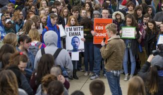 Ethan Cade speaks as Huntington High School students participate in an organized walk-out protest joining students across the nation to raise awareness about gun violence in schools on Wednesday, March 14, 2018, in Huntington, W. Va. The national walk out was also in honor of the 17 victims of the Marjory Stoneman Douglas High School massacre that occurred on Feb. 14.(Sholten Singer /The Herald-Dispatch via AP)