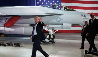 President Donald Trump waves as he walks off after participating in a roundtable discussion on tax policy at the Boeing Company, Wednesday, March 14, 2018, in St. Louis. (AP Photo/Evan Vucci)