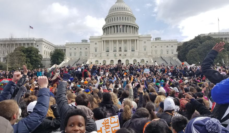 Students from D.C.-area schools rally for stricter gun control legislation Wednesday on the southeast lawn of the U.S. Capitol during the National School Walkout. In similar acts across the nation, students walked out of classes and held a 17-minute moment of silence in honor of the victims in the Valentine's Day massacre at Marjory Stoneman Douglas High School in Parkland, Florida. Photo by Julia Airey / The Washington Times