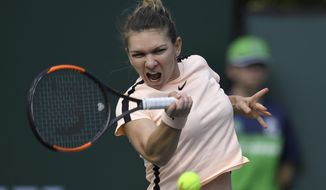Simona Halep, of Romania, hits a forehand to Petra Martic, of Croatia, during the quarterfinals at the BNP Paribas Open tennis tournament Wednesday, March 14, 2018, in Indian Wells, Calif. (AP Photo/Mark J. Terrill)