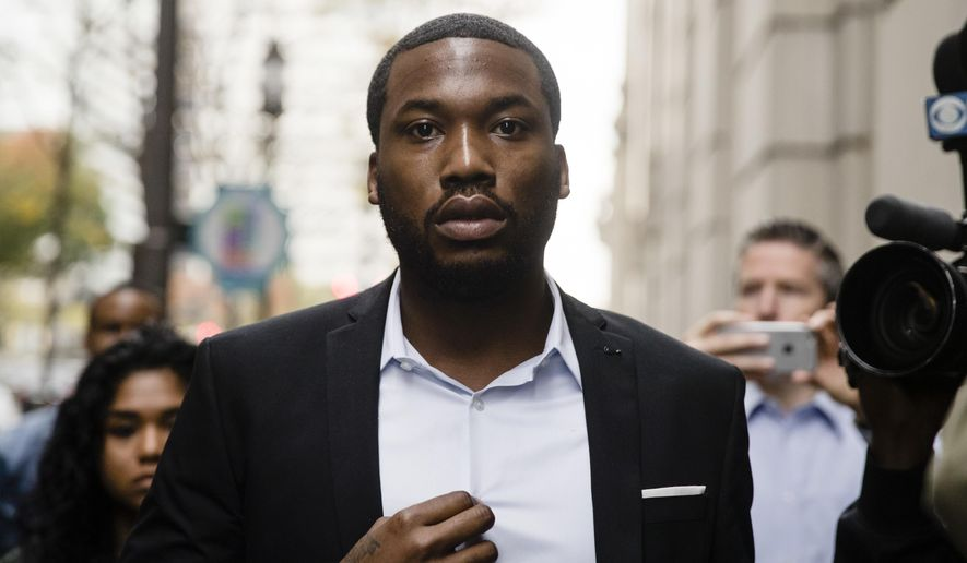 "FILE - In this Nov. 6, 2017 file photo, rapper Meek Mill arrives at the criminal justice center in Philadelphia. The mother of jailed rapper Meek Mill is calling on Philadelphia's district attorney to ""step in"" and help her son. The Philadelphia Inquirer reports the plea by Kathy Williams came during a brief news conference Tuesday before the start of a criminal justice panel at the University of Pennsylvania. Williams strongly criticized the judge who sentenced Mill to two to four years in prison last fall for violating probation on a roughly decade-old gun and drug case.  (AP Photo/Matt Rourke, File)"