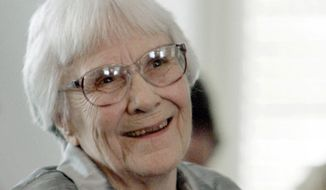 """FILE - In this Aug. 20, 2007 file photo, author Harper Lee smiles during a ceremony honoring the four new members of the Alabama Academy of Honor at the Capitol in Montgomery, Ala. The estate of """"To Kill a Mockingbird"""" author Lee has filed suit over an upcoming Broadway adaptation of the novel set to open in Dec. 2018. The federal lawsuit filed this week in Alabama argues that screenwriter Aaron Sorkin's script wrongly alters Atticus Finch and other characters from the book.  (AP Photo/Rob Carr, File)"""