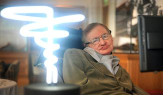 """In this Feb. 25, 2012, file photo, Professor Stephen Hawking poses beside a lamp titled """"black hole light"""" by inventor Mark Champkins, presented to him during his visit to the Science Museum in London. Hawking, whose brilliant mind ranged across time and space though his body was paralyzed by disease, died early Wednesday, March 18, 2018, a University of Cambridge spokesman said. He was 76. (Anthony Devlin/PA via AP)"""