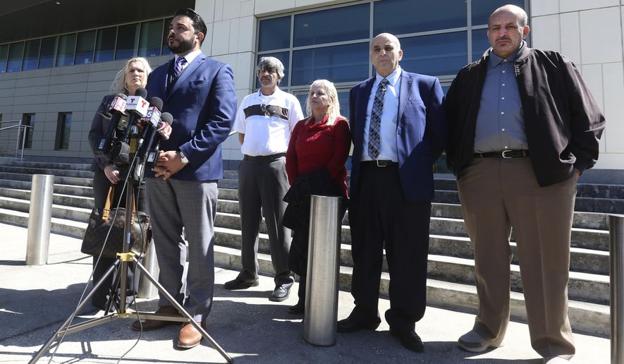 Susan Clary, spokesperson for Noor Salman's family, Ahmed Bedier, President, United Voices For America, 2nd from left, and the four members of Noor Salman's family, right, address the media Wednesday, March 14, 2018, outside the Federal courthouse in Orlando, Fla. Salman went on trial Wednesday in Orlando. The 31-year-old is accused of aiding and abetting her husband in his attack on the Pulse nightclub in June of 2016. (Red Huber/Orlando Sentinel via AP)