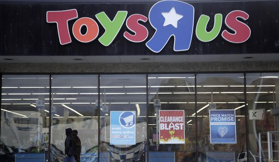 This Jan. 24, 2018, file photo shows a person walking near the entrance to a Toys R Us store, in Wayne, N.J.  (AP Photo/Julio Cortez, File)