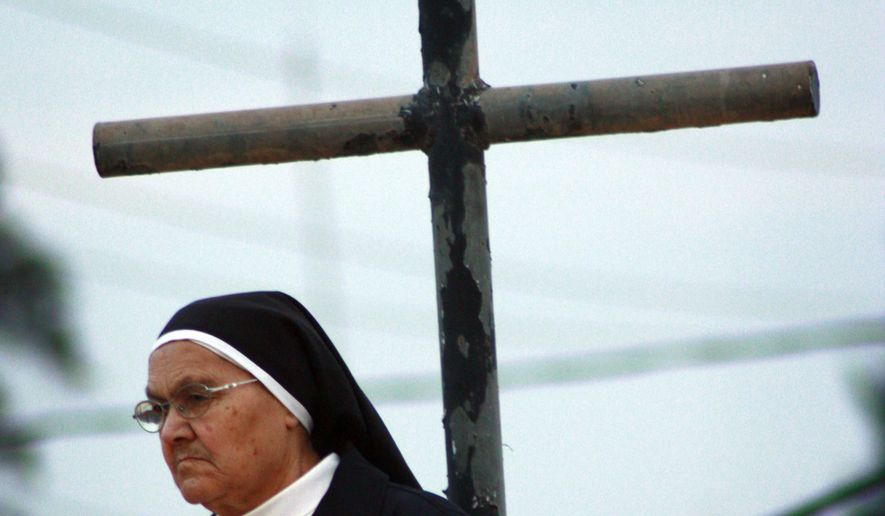 An Iraqi catholic nun is seen before Christmas Eve mass in Mosul, 360 kilometers (225 miles) northwest of Baghdad on Dec. 24, 2009. (Associated Press) **FILE**
