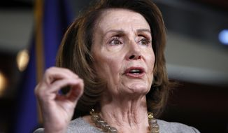 House Minority Leader Nancy Pelosi, California Democrat, speaks to the media on Capitol Hill in Washington on Feb. 8, 2018. (AP Photo/Jacquelyn Martin) **FILE**