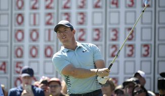 Rory McIlroy, of Northern Ireland, watches his tee shot on the 11th hole during the first round of the Arnold Palmer Invitational golf tournament Thursday, March 15, 2018, in Orlando, Fla. (AP Photo/Phelan M. Ebenhack) ** FILE **