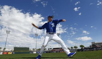Actor Jim Caviezel warms up before throwing out the first pitch at a spring training baseball game between the Kansas City Royals and the Chicago Cubs on Wednesday, March 14, 2018, in Surprise, Ariz. The Royals defeated the Cubs 7-6. (AP Photo/Ross D. Franklin) ** FILE **