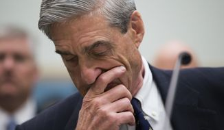 In a photo taken Thursday, June 13, 2013, the House Judiciary Committee hears from then-FBI Director Robert Mueller as it holds an oversight hearing on the Federal Bureau of Investigation, on Capitol Hill in Washington, Thursday, June 13, 2013. (AP Photo/J. Scott Applewhite)