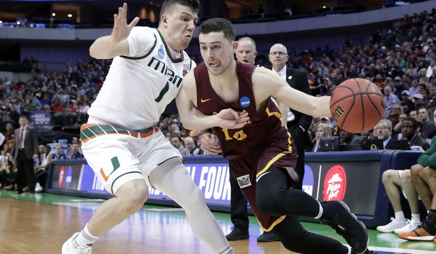 Miami guard Dejan Vasiljevic (1) defends as Loyola-Chicago guard Ben Richardson (14) drives to the basket in the first half of a first-round game at the NCAA college basketball tournament in Dallas, Thursday, March 15, 2018. (AP Photo/Tony Gutierrez)