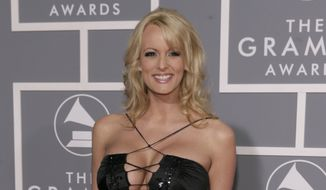 In this Feb. 11, 2007, file photo, adult film actress Stormy Daniels arrives for the 49th Annual Grammy Awards in Los Angeles. (AP Photo/Matt Sayles, File)