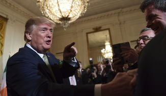 President Donald Trump greets people during a St. Patrick's Day reception in the East Room of the White House in Washington, Thursday, March 15, 2018. Irish Prime Minister Leo Varadkar presented Trump with a traditional gift of a bowl of shamrocks. (AP Photo/Susan Walsh)