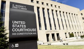 FILE - In this Sept. 22, 2014, file photo, a view of the E. Barrett Prettyman U.S. Courthouse in Washington. The American Civil Liberties Union is suing the Trump administration, claiming it is violating immigration laws and its own policies by detaining immigrants who have a solid case for seeking asylum in the United States. The ACLU said it was filing a lawsuit Thursday in U.S. District Court in Washington claiming that the Immigration and Customs Enforcement agency is detaining many asylum seekers for months while they await hearings before an immigration judge.  (AP Photo/Susan Walsh, File)