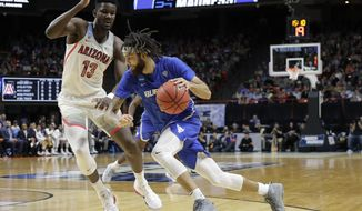 Buffalo guard Jeremy Harris, right, drives around Arizona forward Deandre Ayton (13) during the first half of a first-round game in the NCAA men's college basketball tournament Thursday, March 15, 2018, in Boise, Idaho. (AP Photo/Otto Kitsinger)