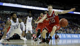 Seton Hall guard Myles Powell (13) and North Carolina State guard Braxton Beverly (10) chase a loose ball during the first half of an NCAA college basketball tournament first-round game Thursday, March 15, 2018, in Wichita, Kan. (AP Photo/Charlie Riedel)