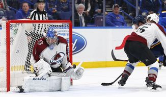 Colorado Avalanche goaltender Semyon Varlamov, left, of Russia, blocks a shot by St. Louis Blues' Vladimir Tarasenko, of Russia, as he is defended by Duncan Siemens during the second period of an NHL hockey game Thursday, March 15, 2018, in St. Louis. The Avalanche won 4-1. (AP Photo/Billy Hurst)