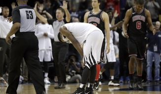 Memphis Grizzlies guard Tyreke Evans, center, pauses on the court after his team lost to the Chicago Bulls in an NBA basketball game Thursday, March 15, 2018, in Memphis, Tenn. (AP Photo/Mark Humphrey)
