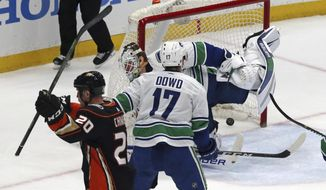 Anaheim Ducks left winger Jason Chimera (20) celebrates his goal against Vancouver Canucks center Nic Dowd (17) and goalie Jacob Markstrom during the second period of an NHL hockey game in Anaheim, Calif., Wednesday, March 14, 2018. (AP Photo/Reed Saxon)