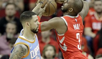 Houston Rockets' Chris Paul (3) is fouled by Los Angeles Clippers' Austin Rivers (25) during the first half of an NBA basketball game Thursday, March 15, 2018, in Houston. (AP Photo/David J. Phillip)