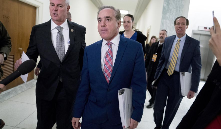 Rep. Steve Womack, R-Ark., left, greets Veterans Affairs Secretary David Shulkin, center, as he arrives for a House Appropriations subcommittee hearing on Capitol Hill in Washington, Thursday, March 15, 2018. (AP Photo/Andrew Harnik)
