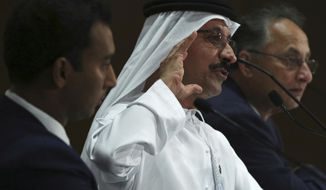Sultan Ahmed bin Sulayem, center, the group chairman and CEO of Dubai-backed port operator DP World, speaks during a news conference in Dubai, United Arab Emirates, Thursday, March 15, 2018. DP World announced Thursday that its profits rose by 7 percent to nearly $1.2 billion in 2017 as it expands in India, Brazil, the Horn of Africa and elsewhere. (AP Photo/Jon Gambrell)