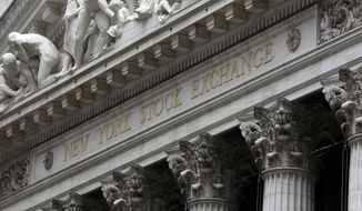 FILE - This Oct. 2, 2014, file photo shows the facade of the New York Stock Exchange.T he U.S. stock market opens at 9:30 a.m. EST on Thursday, March 14, 2018. (AP Photo/Richard Drew, File)