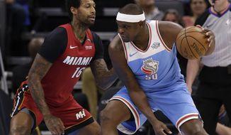 Miami Heat forward James Johnson, left, defends against Sacramento Kings forward Zach Randolph during the first quarter of an NBA basketball game Wednesday, March 14, 2018, in Sacramento, Calif. (AP Photo/Rich Pedroncelli)
