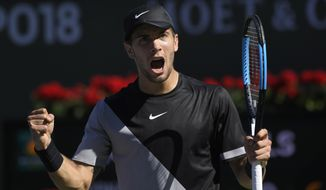Borna Coric, of Croatia, celebrates after winning a game against Kevin Anderson, of South Africa, during the quarterfinals at the BNP Paribas Open tennis tournament, Thursday, March 15, 2018, in Indian Wells, Calif. (AP Photo/Mark J. Terrill)