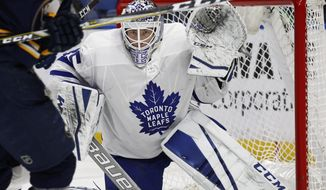 Toronto Maple Leafs goalie Curtis McElhinney (35) watches the puck during the third period of an NHL hockey game against the Buffalo Sabres, Thursday, March 15, 2018, in Buffalo, N.Y. (AP Photo/Jeffrey T. Barnes)