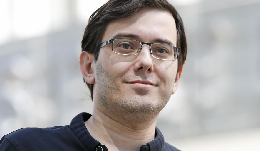 FILE - In this Aug. 4, 2017 file photo, Martin Shkreli talks with reporters after leaving federal court in New York. Shkreli was sentenced to seven years in prison for securities fraud last week. He owns two collectible rap albums by Wu-Tang Clan and Lil Wayne albums that could be auctioned by the government since he has to forfeit more than $7.3 million in a brokerage account and personal assets. (AP Photo/Seth Wenig, File)