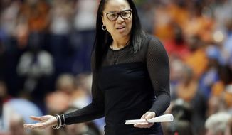 FILE - In this Friday, March 2, 2018, file photo, South Carolina head coach Dawn Staley reacts to a call during the second half of an NCAA college basketball game against Tennessee in the Southeastern Conference tournament in Nashville, Tenn. Staley is a force in women's basketball, directing the defending national champion and coaching the USA women. But she still feels like the NCAA doesn't respect her, making her fans fly to regionals and this season forcing her Gamecocks to likely beat Connecticut to make it to the Final Four. (AP Photo/Mark Humphrey, File)