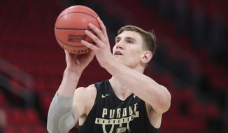 Purdue center Isaac Haas shoots a free throw during practice at the NCAA college basketball in Detroit, Thursday, March 15, 2018. Purdue plays Cal State Fullerton in the first round on Friday. (AP Photo/Carlos Osorio)