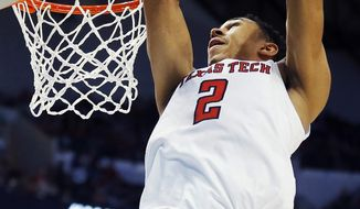 Texas Tech guard Zhaire Smith (2) completes an alley-oop during the first half of a first-round game at the NCAA college basketball tournament against Stephen F. Austin in Dallas, Thursday, March 15, 2018. (AP Photo/Brandon Wade)