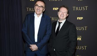 "Director and executive producer Danny Boyle, left, poses with creator, writer and executive producer Simon Beaufoy at a special screening of FX Networks' ""Trust"" at Florence Gould Hall on Wednesday, March 14, 2018, in New York. (Photo by Evan Agostini/Invision/AP)"