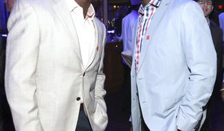 FILE - In this Jan. 31, 2013, file photo,  NFL football players Jason McCourty, left, Devin McCourty pose at the VIP Reception hosted by the NFLPA in New Orleans. The McCourty twins are back together. The Cleveland Browns traded cornerback Jason McCourty to the New England Patriots, reuniting him with his brother, Devin, on Thursday, March 15, 2018. The Browns also sent a seventh-round pick to the Patriots to get a sixth-rounder in return. (Photo by Dario Cantatore/Invision for NFLPA/AP Images, via AP, File)