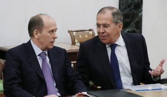 "Russian Foreign Minister Sergey Lavrov speaks to Federal Security Service (FSB) Director Alexander Bortnikov as they attend a security council meeting in the Kremlin in Moscow, Russia, Thursday, March 15, 2018. Lavrov said Thursday that Moscow would ""certainly"" expel some British diplomats in a tit-for-tat response. In remarks carried by the RIA Novosti news agency, Lavrov said the move would come ""soon."" (Mikhail Klimentyev, Sputnik, Kremlin Pool Photo via AP)"
