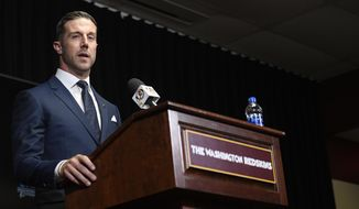 Newly signed Washington Redskins quarterback Alex Smith speaks during the NFL football team's news conference Thursday, March 15, 2018, in Ashburn, Va. (AP Photo/Nick Wass)