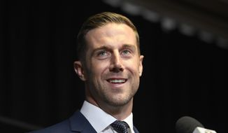 Newly signed Washington Redskins quarterback Alex Smith smiles during the NFL football team's news conference Thursday, March 15, 2018, in Ashburn, Va. (AP Photo/Nick Wass) **FILE**