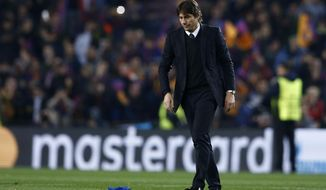 Chelsea head coach Antonio Conte leaves the pitch at the end of the Champions League round of sixteen second leg soccer match between FC Barcelona and Chelsea at the Camp Nou stadium in Barcelona, Spain, Wednesday, March 14, 2018. (AP Photo/Manu Fernandez)