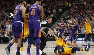 Phoenix Suns' Jared Dudley (3) and Marquese Chriss (0) stand nearby after shoving Utah Jazz's Ricky Rubio, right, to the court during the second of an NBA basketball game Thursday, March 15, 2018, in Salt Lake City. Dudley and Chriss were ejected with a flagrant 2 fouls. (AP Photo/Rick Bowmer)